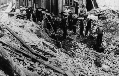 Searching for bodies after a a Japanese airstrike. Canton, 1938. Image from