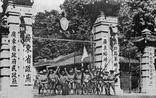 CANTON, CHINA - OCTOBER 21: Japanese soldiers celebrate their victory on October 21,1938 in Canton in front of the entrance of the seat of the Chinese Nationalist government after Japanese column of 3,000 men, led by tanks, stormed into Canton. Image from Getty Images.
