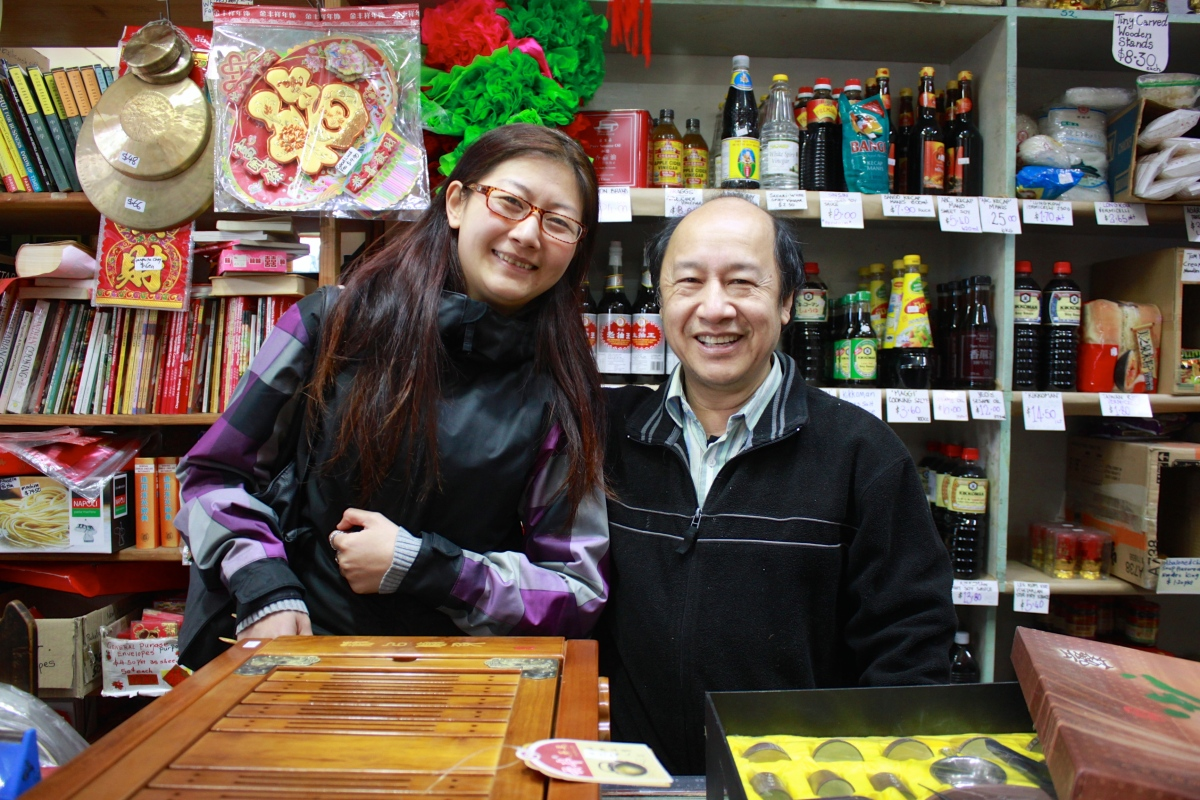 Barry shows a customer one of their traditional Chinese tea sets