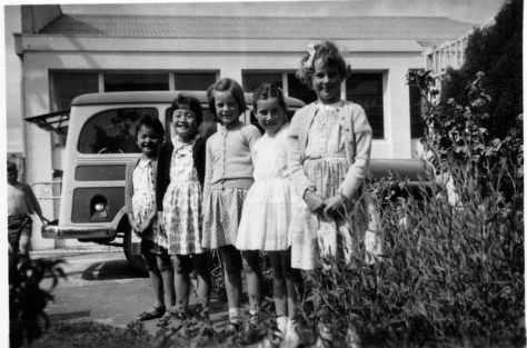 Little Helen and her sister Barbara with some friends at home in Hawera, 1960. Image courtesy of Helen.