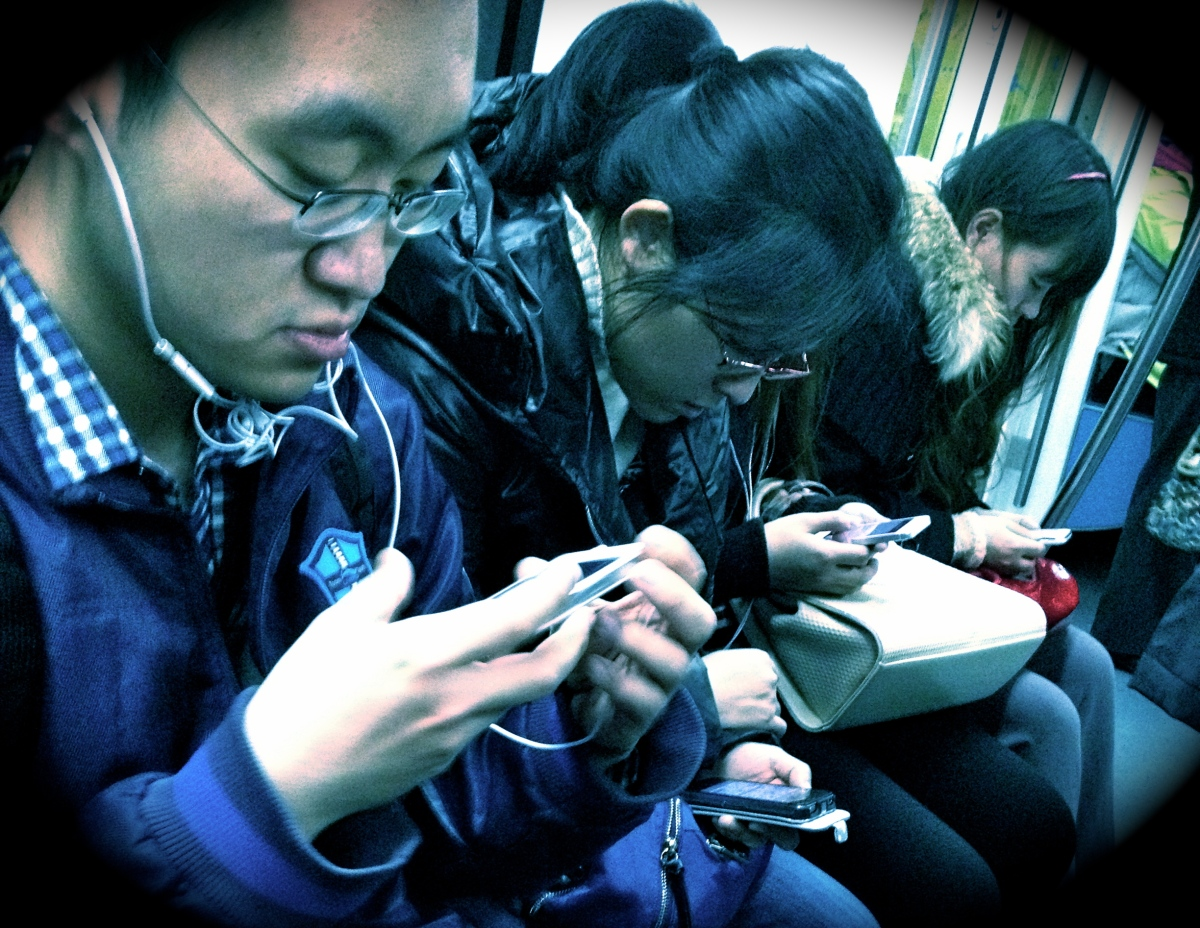 Passengers on the Beijing Metro, 2013.