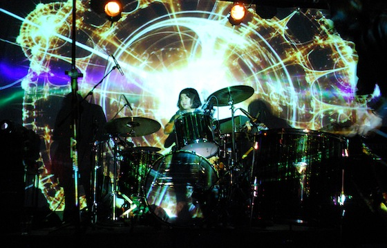 Atom playing with Nova Heart at Yugong Yishan. Image from Live Beijing Music.