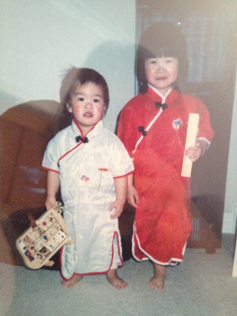 My big sis and I wearing qipao for the one time in our lives ever.