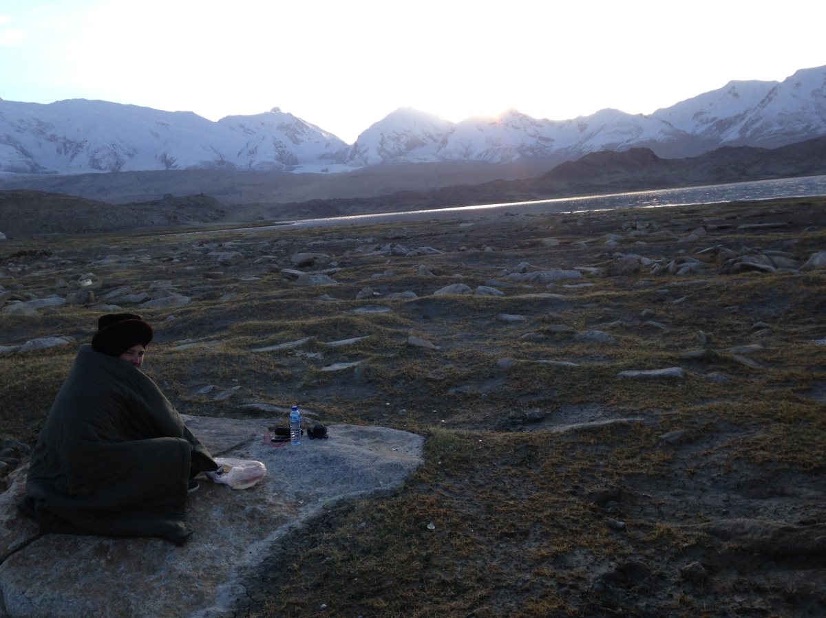 Ben fashioned as a turd at Karakul Lake. Sunrise. Freezing our butts off.